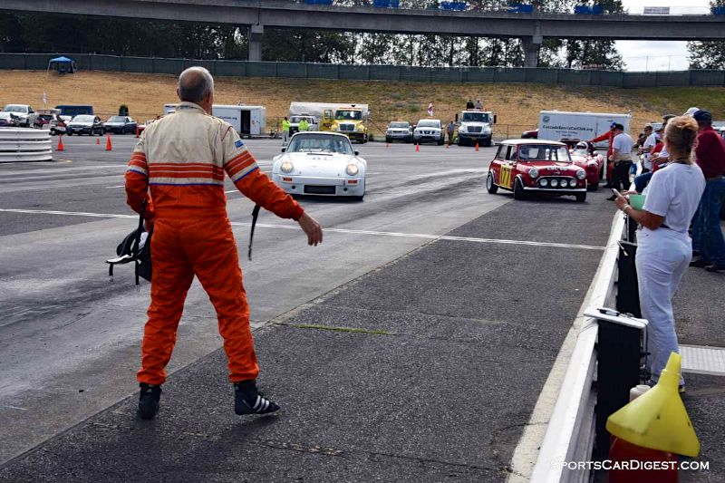 Arthur Connor directs Cameron Healy into pits at  Portland Historic Races 2015
