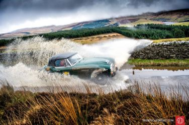 Readers chose Blue Passion's photo of the Austin-Healey 3000 Mk III making a splash on the Three Legs of Mann Rally as the best vintage car racing photo of 2017