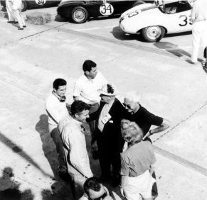 In this group are Pedro Rodriguez, Carroll Shelby in his trademark overalls, Corvette legend Zora Duntov, and Roger Penske's first wife, Lisa. BARC boys photo.
