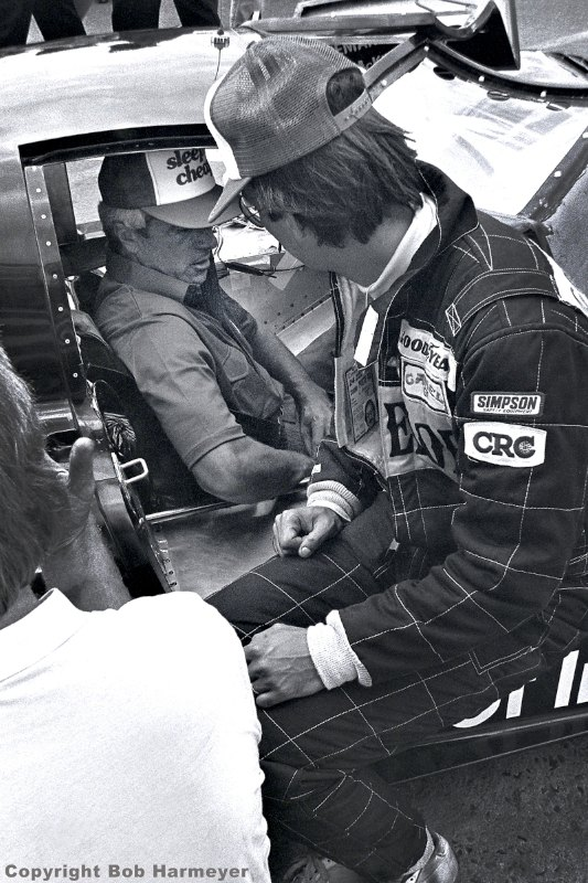 Bobby Rahal watches as co-driver Jim Trueman checks seat belt adjustments in the March 82G/Chevrolet.