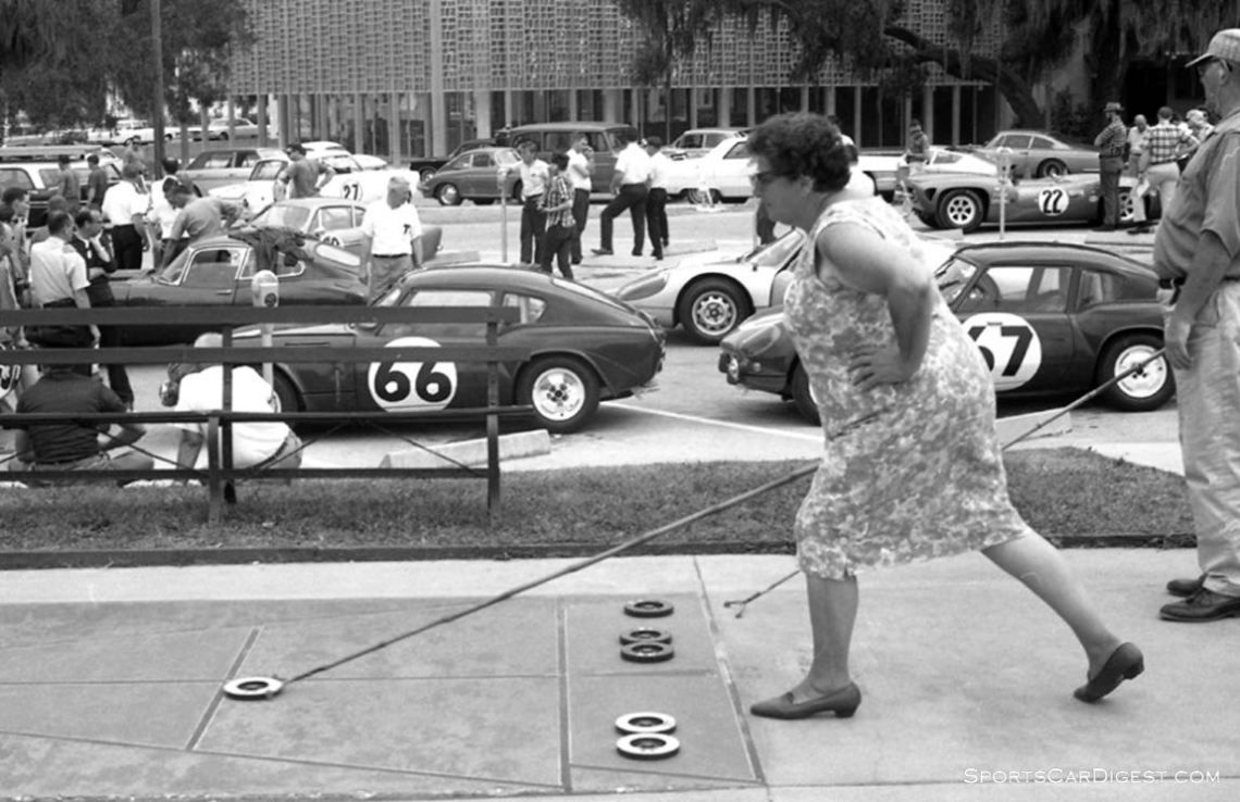 This odd juxtaposition of images of the two factory Triumph Spitfires waiting for tech inspection while local residents play shuffleboard nearby. The #66 Spitfire was driven by Bob Tullius and Charles Gates and finished 30. The #67 Spitfire was driven by Ed Barker, Duane Feuerhelm and Mike Rothschild and finished 29th. (photo: Dave Nicholas)