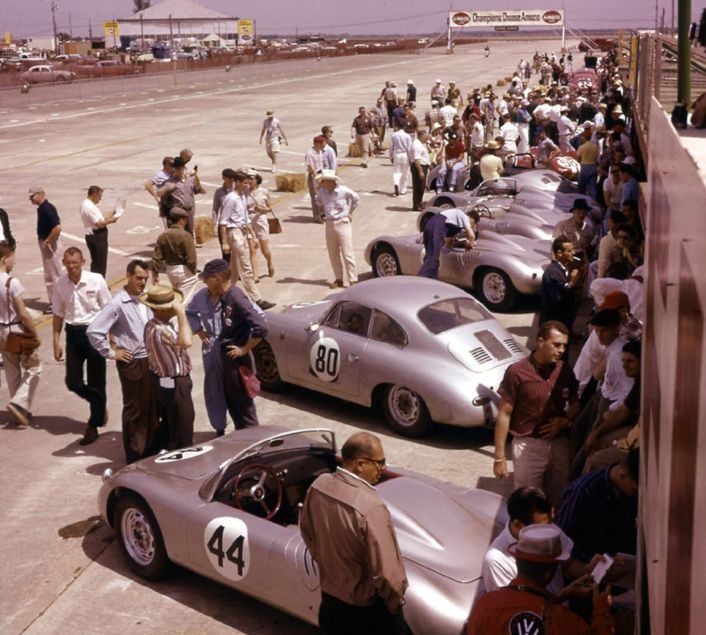 Porsche was out in force in 1960 despite the boycott. Cars are lined up prior to moving to the grid for the Le Mans style start. BARC boys photo.