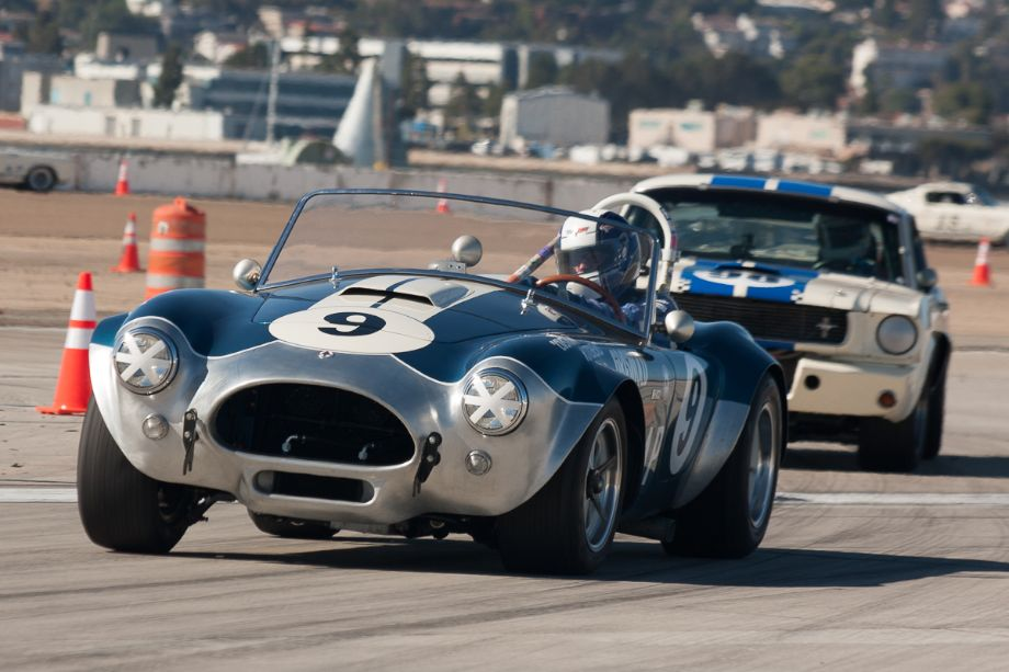 John Goodman holds off a Shelby GT350 in his 1964 Cobra.