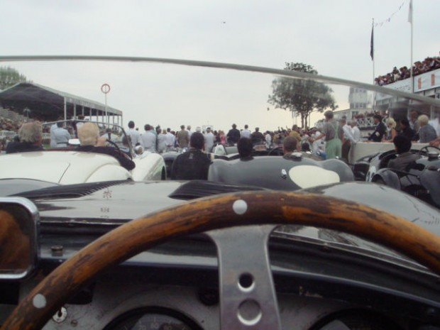 The author Ed McDonough drove this original works C-Type Jaguar in the amazing tribute to Stirling Moss on Sunday. Nearly 100 cars were in the four lap parade. Here they gather on the pit straight as Lord march and American astronaut Buzz Aldrin paid their tributes as well.