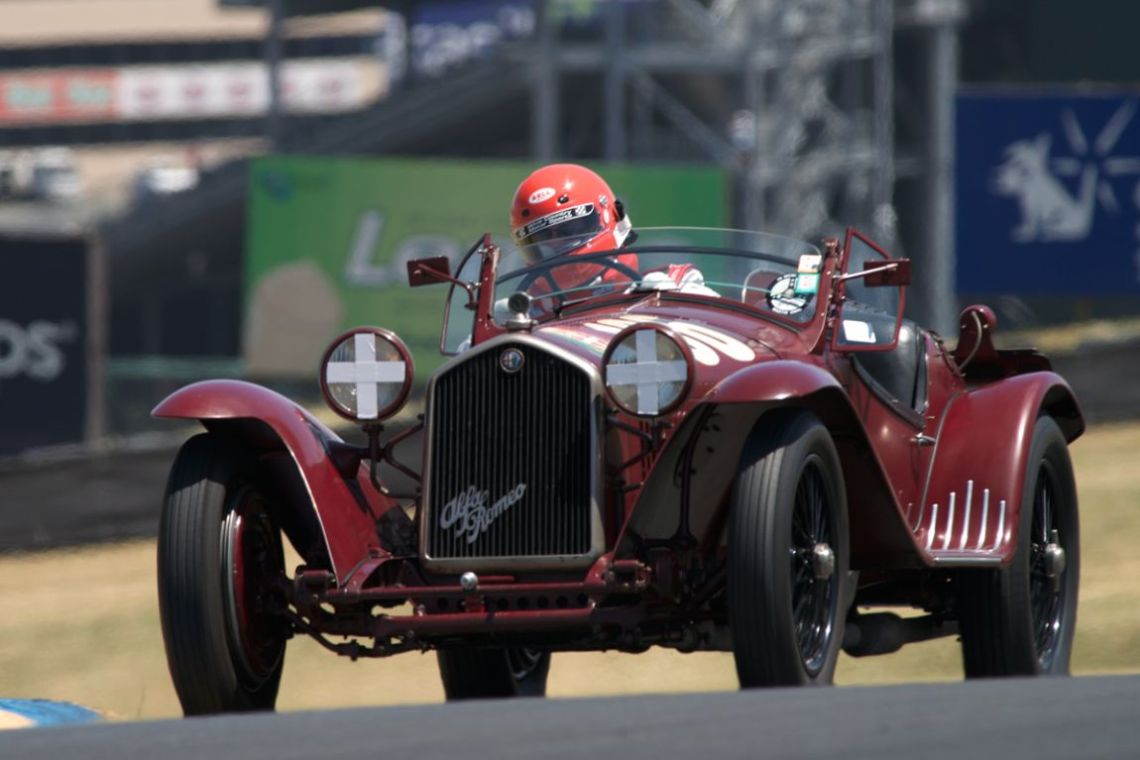 Over the hill between turns three and four Tom price in his 1932 Alfa Romeo 8C 2300MM.