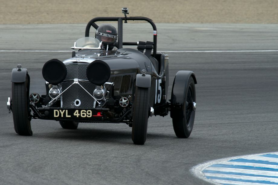 Loading up the outside front tire in turn two is Jeff Lotman in his 1937 Jaguar SS100 2.5 litre.