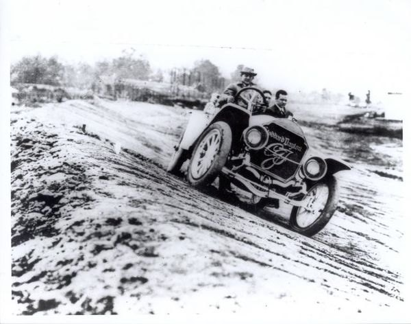 Carl Fisher inspecting the Indianapolis Speedway in 1909