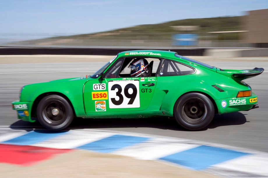 The 1974 Porsche 911 RSR of Dennis Singleton is ignoring the adage to keep all four wheels on the ground. (photo: Andrew Buckley)