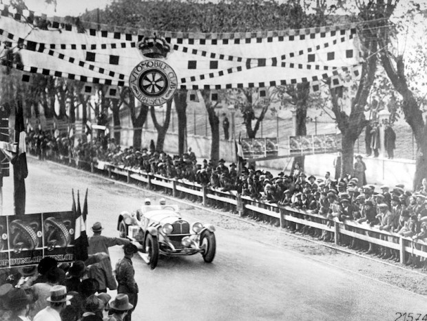1931 Mille Miglia. Rudolf Caracciola and his co-driver Wilhelm Sebastian in a Mercedes-Benz SSKL racing car at the finish line in Brescia. It is the first time that a foreigner is the overall winner of this famous Italian race.