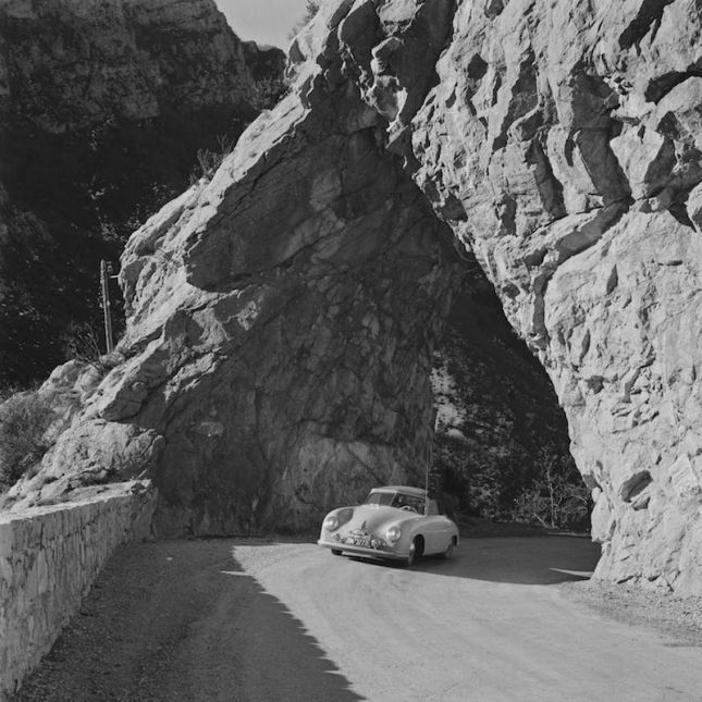 Brilliant use of natural geographic settings characterizes much of Mailander's work, as is the case with this wonderful image of the 1954 Porsche 356 Press Car emerging from under a rock bridge in Monte Carlo