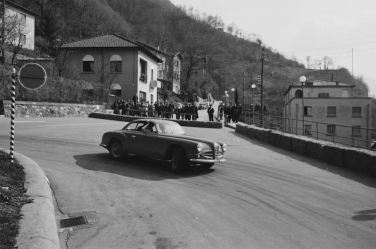 The ability to take you right into the action, as with this image of an Alfa Romeo manipulating a controlled corner slide on the Racing Driver's Course, in Campione, Switzerland, fueled the high demand for Mailander's work.