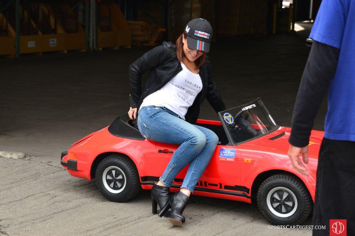 Amanda Elkins climbs into Kerry Morse's mini 911 Carrera (Photo: Trevor Ely)