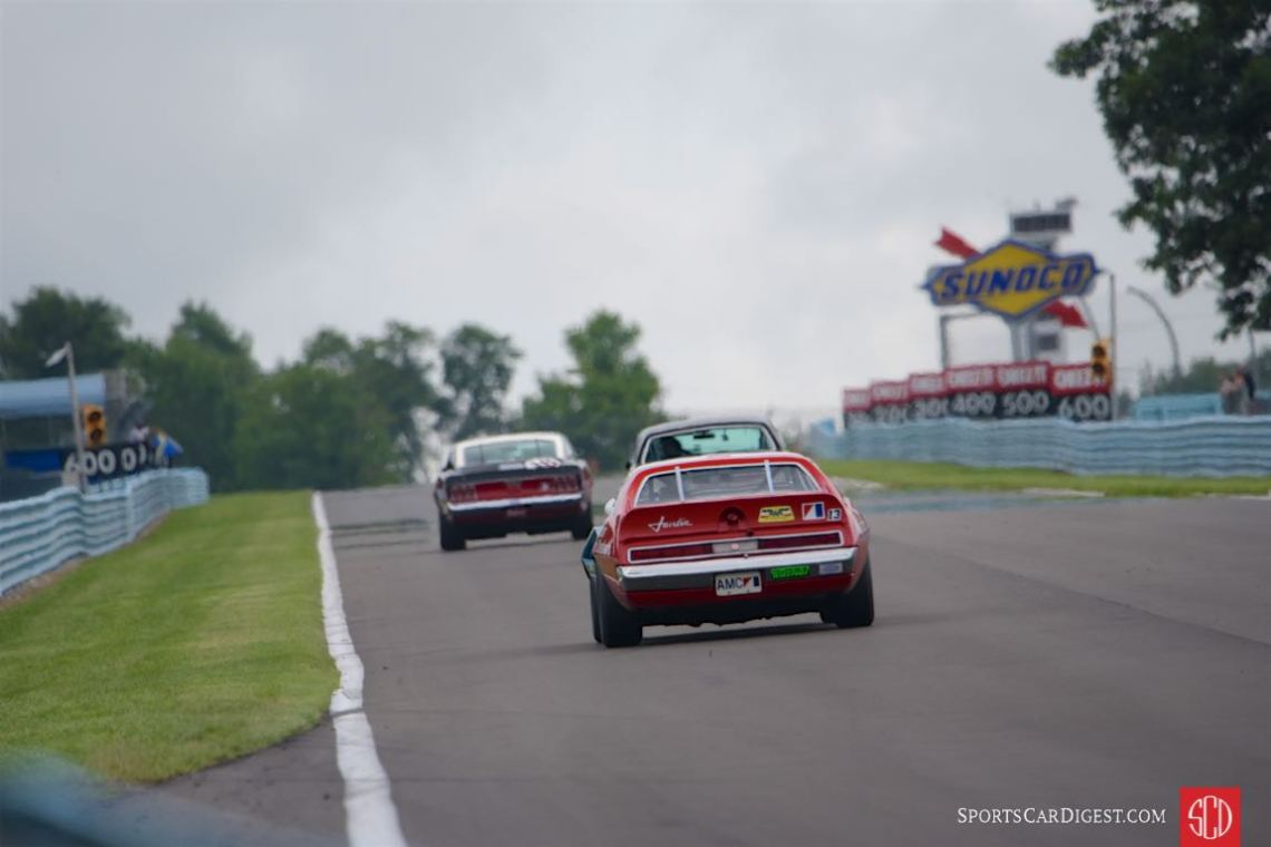 Historic Trans Am on the back straight .