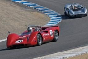 David Hankin's 1968 McLaren M6B leads Brad Hoyt in his 1966 McLaren M1B down the Corkscrew