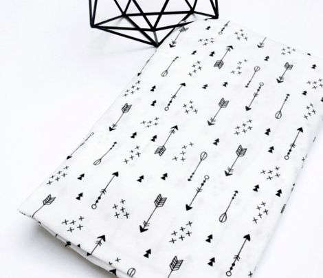 Geometric black and white arrows and cross abstract