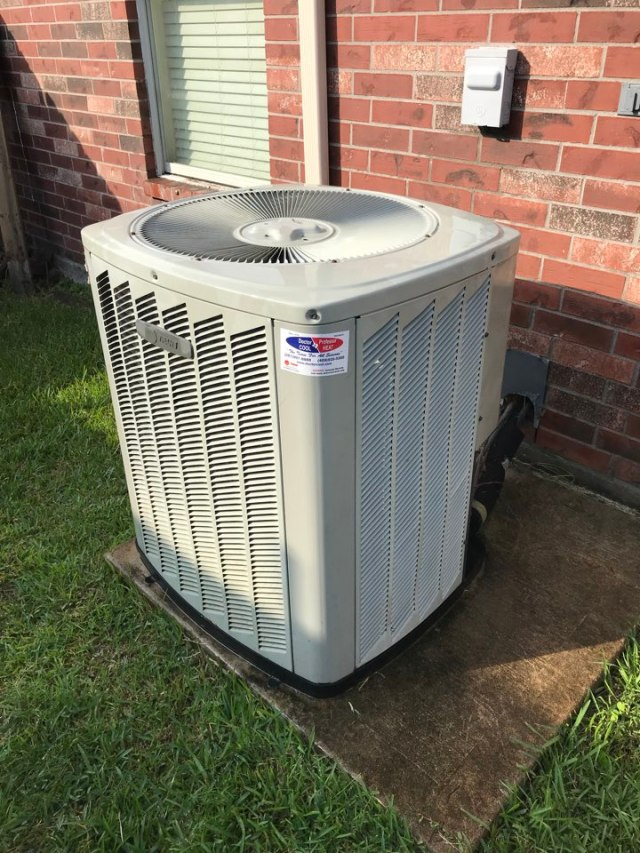 Dickinson, TX - Performing an A/C check on Trane system. 13 year old system still running strong