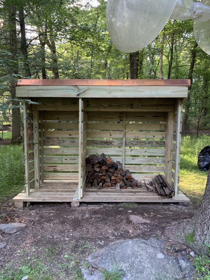 Columbia, MD - Custom built firewood shed with hand dipped cedar shake roof shingles and copper trim! Built for the in-laws.