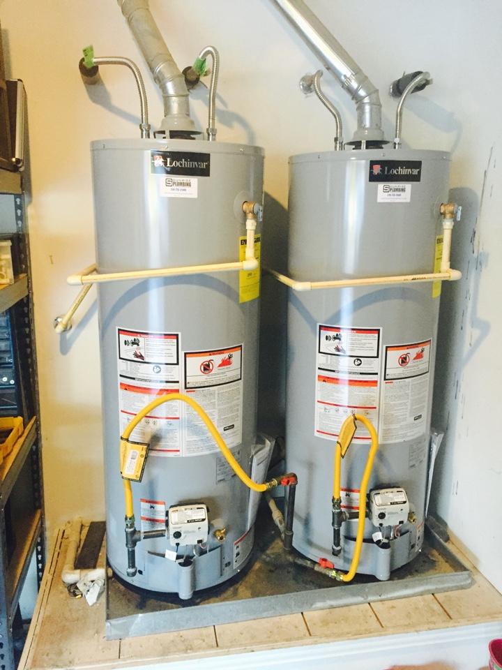 Murphy, TX - Installing two new Lochinvar 50 gallon gas water heater in garage