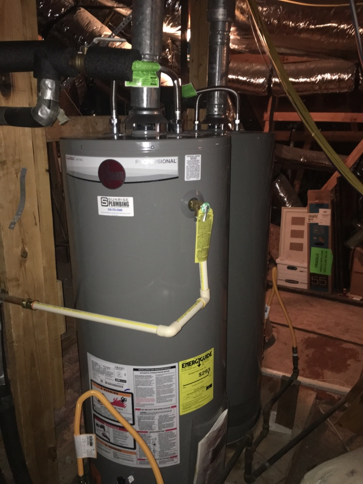 McKinney, TX - Water heater leaking in attic. Homeowner has 3 12 year old water heaters she wants replaced not repaired. Install 3 new Rheem water heaters.