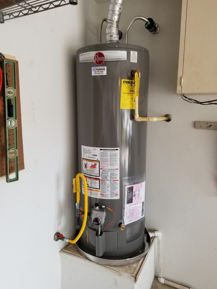 Sachse, TX - Homeowner has 15 year old water heater wants to replace. Install new 50 gallon 8 year warranty water heater in garage. Sachse Plumbers.