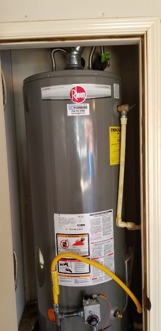 Rowlett, TX - 50 gallon gas water heater and garage closet is not producing hot water. Need repair. Install new 50 gallon gas water heater with drain ran to garage floor.  Rowlett plumbers