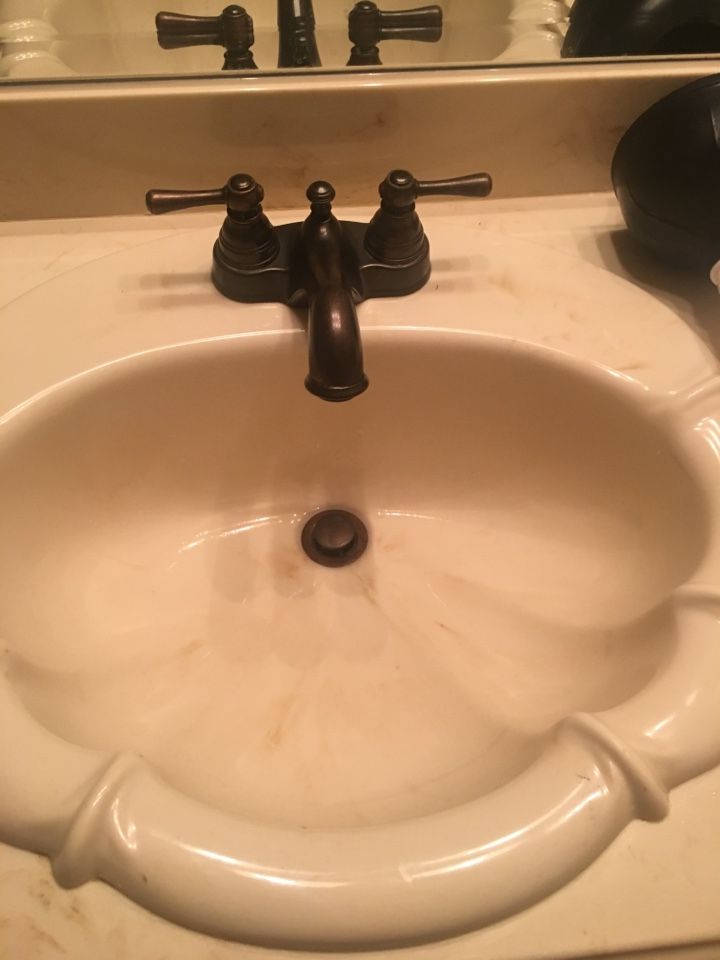 Royse City, TX - Bathroom sink clogged. Clear stoppage by taking apart p trap and running cable down drain line.