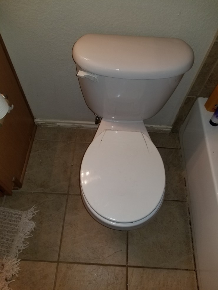 Rockwall, TX - Toilet and hallway guest bathroom not flushing need repair.  Auger toilet to clear stoppage. Royse City plumbers