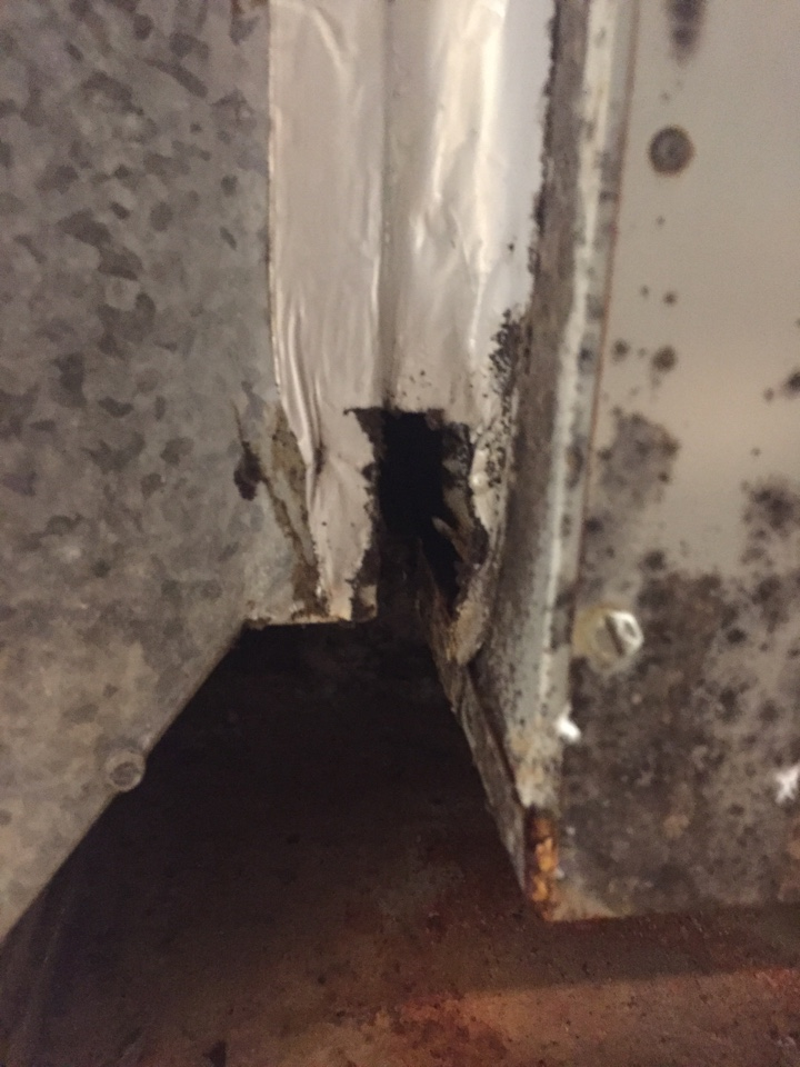 Baytown, TX - Air leak and bare metal plenum in this attic is leaking water on the ceiling.