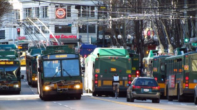 Buses and one car on 3rd