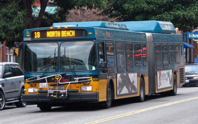 """Articulated Metro coach signed """"18 North Beach"""""""