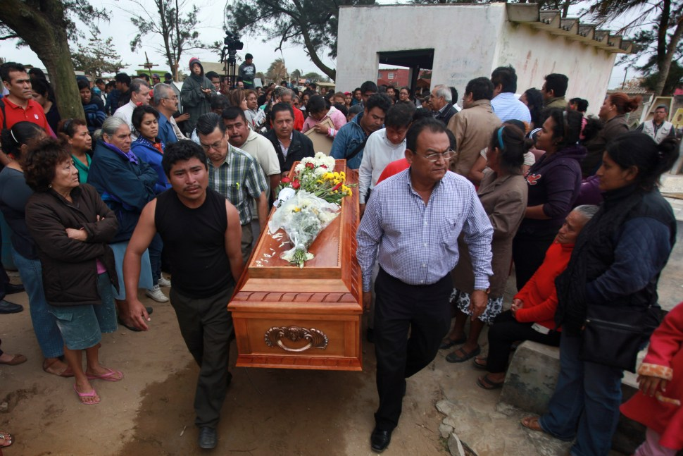 Relatives carry the coffin that contain the remains of slain journalist Gregorio Jimenez as they walk towards the cemetery in Coatzacoalcos, Mexico, Wednesday, Feb. 12, 2014. Veracruz state officials concluded that Jimenez, a police beat reporter, was killed in a personal vendetta, unrelated to his reporting. But journalists throughout Mexico are calling for a thorough investigation. Jimenez is the 12th journalist slain or gone missing since 2010 in the Gulf state of Veracruz. (AP Photo/Felix Marquez)