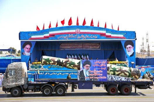 A truck carries a locally modified S-200 surface-to-air missile during a military parade in Iran in 2016.
