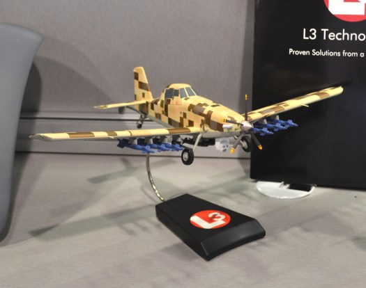 A model of the AT-802L in a desert digital camouflage paint job.
