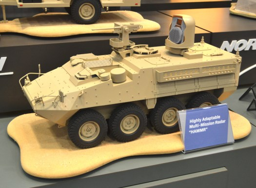 The model of a Stryker equipped with Northrop Grumman's HAMMR. The radome is cut away to show the radar itself within.