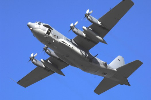 A late model AC-130H with a pair of observation windows in the forward fuselage in lieu of two M61 Vulcan cannons.