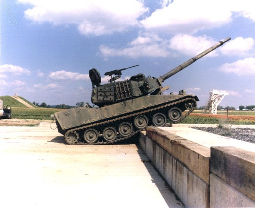 The M8 Armored Gun System navigates an obstacle at Aberdeen Proving Ground during tests in the 1990s.