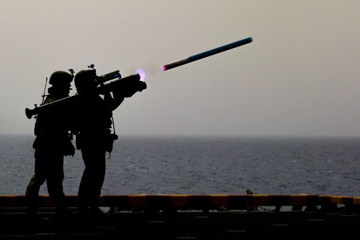 Marines from the 26th Marine Expeditionary Unit fire a Stinger trainer missile from the deck of the <em data-recalc-dims=