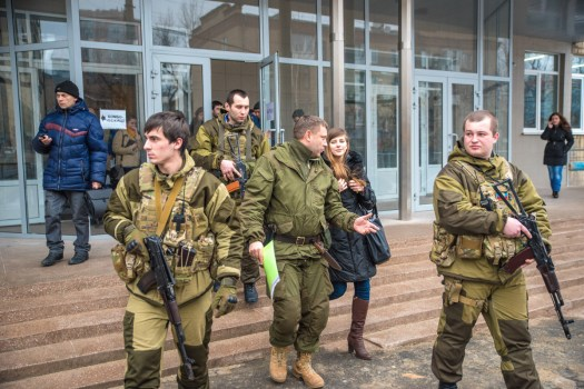 Alexander Zakharchenko, at center, speaks a university student, in a black coat, after a press conference in 2015.