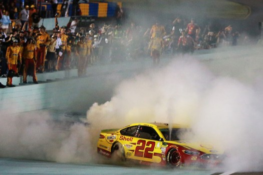 Joey Logano celebrates a race win and NASCAR championship simultaneously at Homestead-Miami Speedway on Nov. 18, 2018.