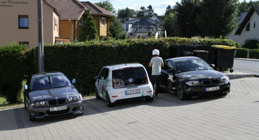 You really notice how small Volkswagen's smallest car is when it's parked between two BMWs.