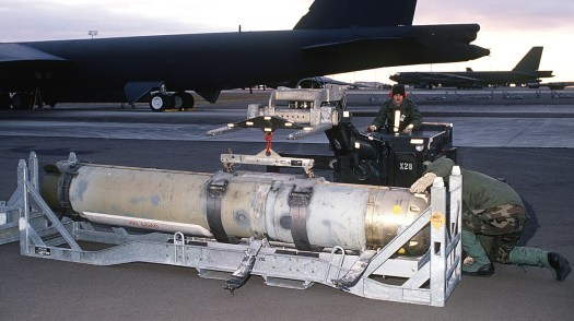 Airmen prepare to load a Mk 60 CAPTOR onto a B-52G bomber during an exercise in 1989.