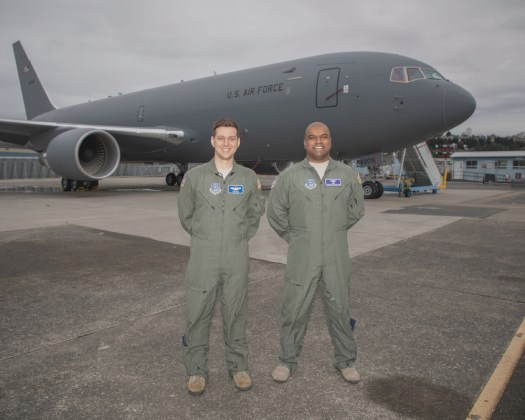 US Air Force Major Nick Cenci, Chief of Flight Operations, Defense Contract Management Agency (Seattle), at left, and Major Anthony Mariapain, KC-46 Chief Pilot Defense Contract Management Agency (Seattle), stand in front of the first KC-46A that the Air Force has accepted from Boeing. These individuals led the acceptance flight testing.