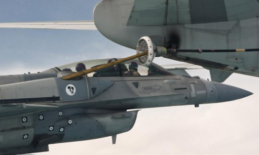Lockheed Martin personnel use a Block 60 F-16F to test the Conformal Air Refueling Tank System in 2010. The logo of the company's <a href=