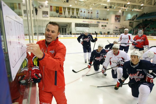 BELLEVILLE, CANADA - SEPTEMBER 14: Head Coach Adam Oates of the Washington Capitals goes over a drill with his team at Yardman Arena during Kraft Hockeyville Day 2 on September 14, 2013 in Belleville, Ontario, Canada. (Photo by Dave Sandford/NHLI via Getty Images)