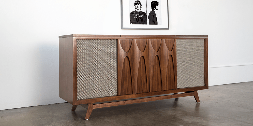 This beautiful record player console comes with whiskey