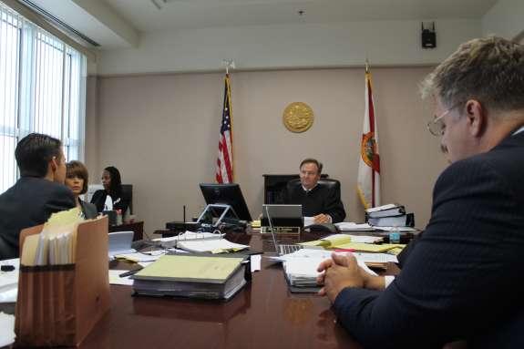 Orange County Judge John Jordan hears arguments from Disney attorney John Ward Smith (L) and Roscoe attorney Brian Denney (R). Photo: Renata Sago.