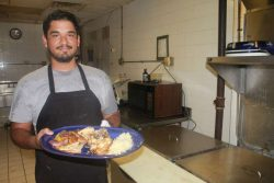 Marco Novella of Dimitri's Bar Deck and Grill says more diners are ordering up lionfish. Photo by Amy Green