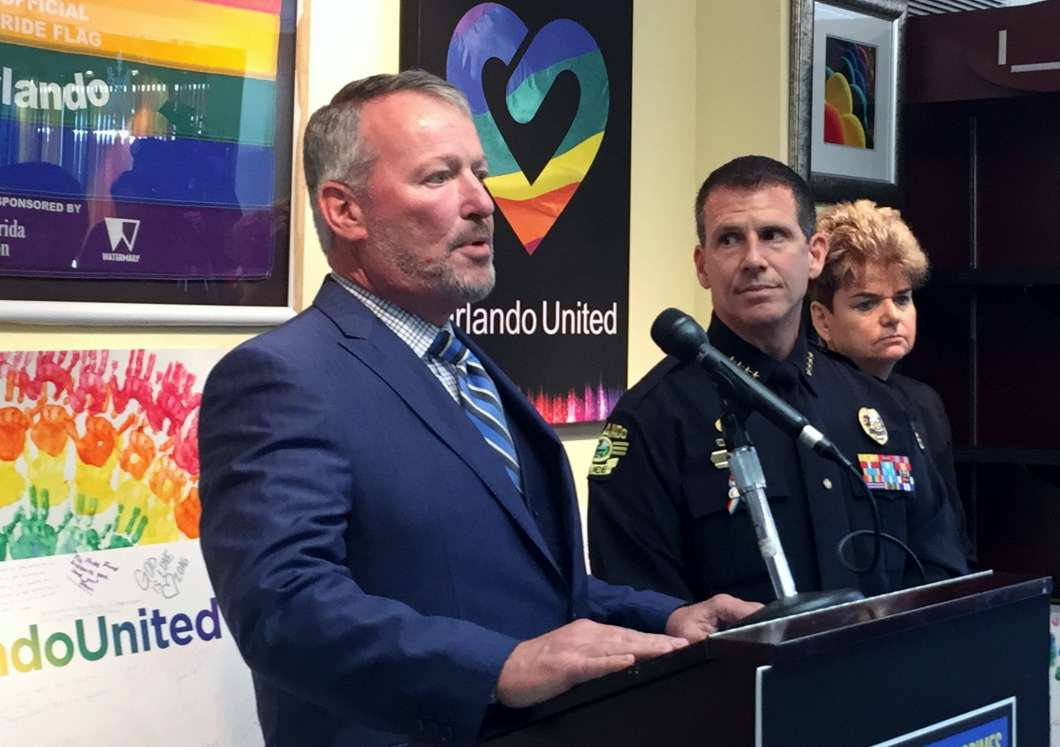Photo, L to R: Orlando Mayor Buddy Dyer, Orlando Police Department Chief John Mina, District 4 Commissioner Patti Sheehan.