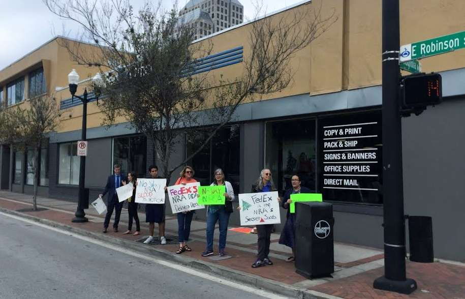 Gun reform advocates in Orlando say FedEx is helping the National Rifle Association grow its membership. Photo: WMFE.