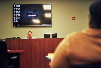 Puzone leads a class as part of the juvenile defense clinic at Barry University School of Law. Photo: Joey Roulette.